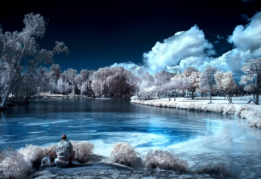 Infrared photography: The Fisherman by Roie Galitz